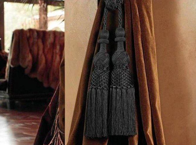 Nothing looks lusher than velvet trimmed curtains spilling on to the floor.