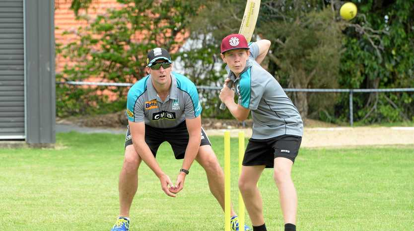 Brisbane Heat player Luke Feldman with Scott Skinner on bat at the cricket coaching clinic held at the RGS grounds.