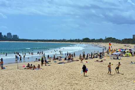 The popular Mooloolaba Beach, with dozens of people swimming outside the flags.