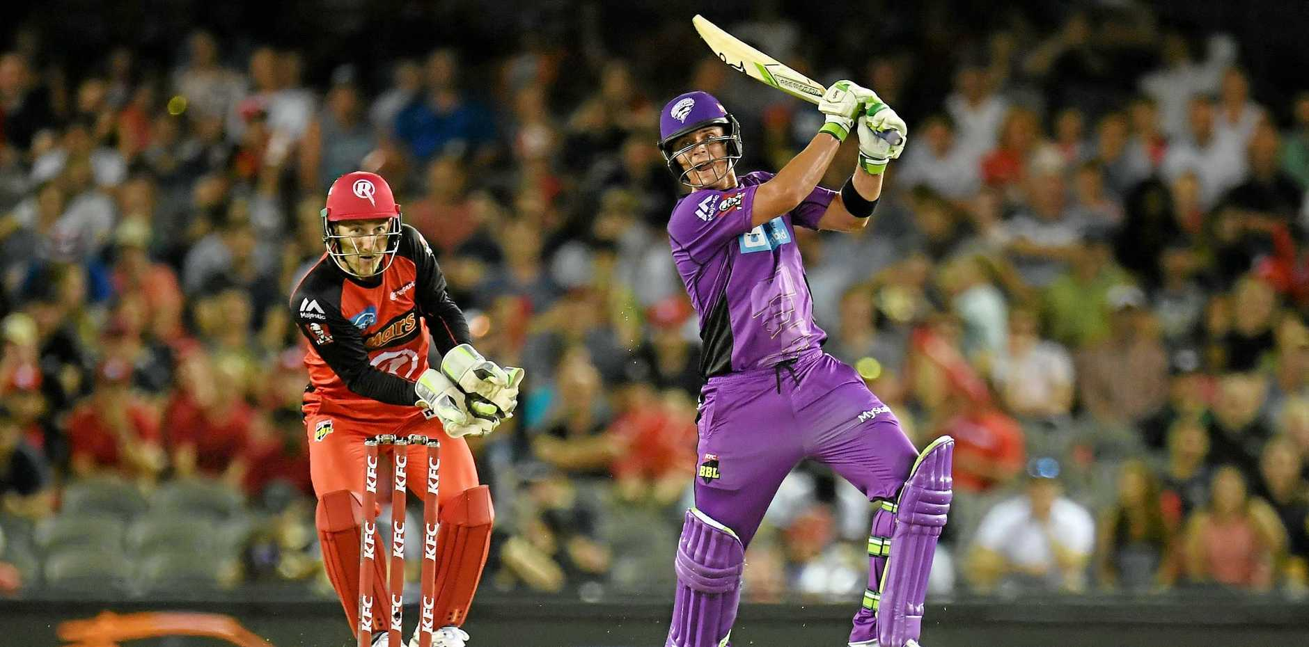 Ben McDermott of the Hurricanes (right) plays a shot during the Big Bash League match against the Melbourne Renegades at Etihad Stadium.