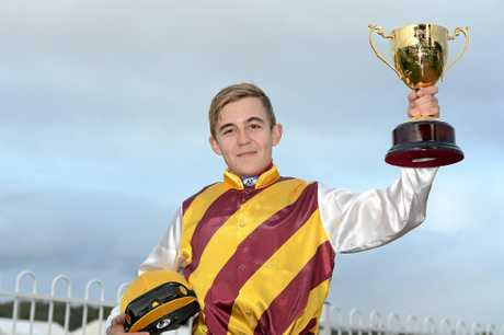 Ipswich Cup 2015 at Ipswich Turf Club.Ipswich Cup race 6 winner no. 6 Danchai, jockey: Luke Tarrant, trainer: Chris Waller.Luke Tarrant with the Cup.Photographer Kate Czerny / Queensland Times