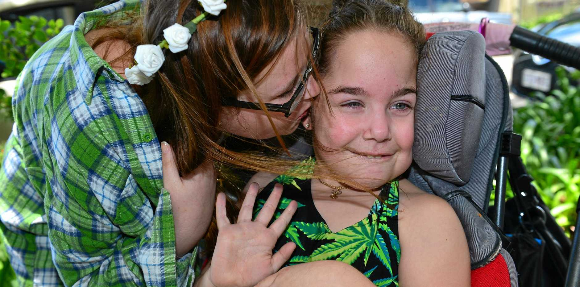 HAPPY AND HEALTHY: When medicated with marijuana oil, Kaitlyn is a playful child.