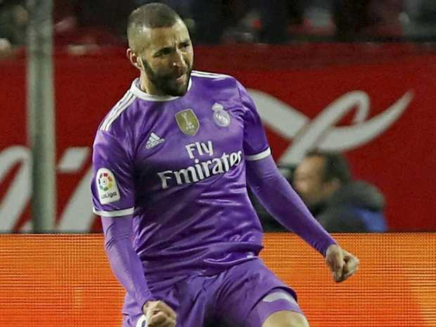 RECORD GOAL: Real Madrid's French striker Karim Benzema celebrates after scoring to give his club a 3-all draw and a record 40 games without defeat.