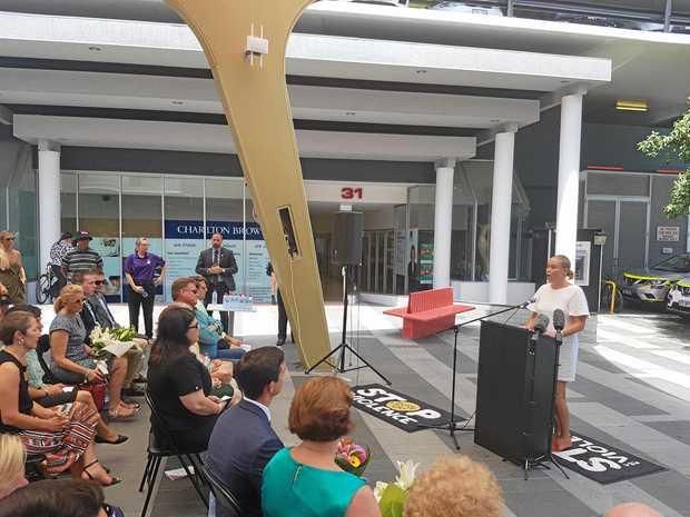 Cole Miller's sister Kate speaks at a memorial in Brisbane.
