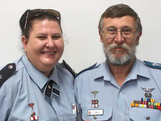 AWARDED FOR SERVICE: QAS advanced care paramedic Helen Geddes with paramedic Stephen Eggleston with his National Emergency Medal for sustained service.