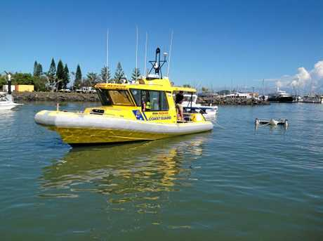 RMH Rescue towing catamaran into the Rosslyn Bay Harbour.