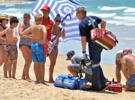 A young man was pulled from the water at Mooloolaba after suffering what appeared to be a seizure.