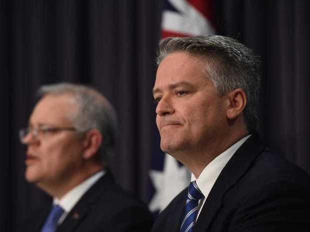 Australia's Treasurer Scott Morrison and Australia's Finance Minister Mathias Cormann speak to the media during a press conference.
