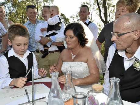 Toowoomba couple Meagan Horne and Rene Derksen, surrounded by family sign the register. The couple were gifted a perfect wedding at Reflections - Lake Cooby . My Wedding Wish gift weddings to couples affected by terminal illness. January 13, 2017