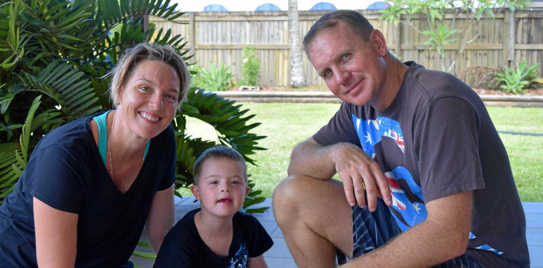 Founder of All Abilities Mackay Bec Nicol believes the current roll-out of the NDIS is leaving some families confused and angry. Picture; Bec Nicol with son Reef and husband Peter.