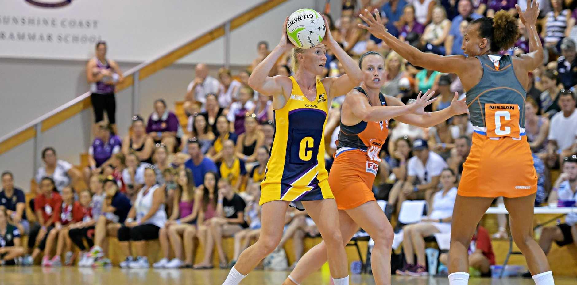 HELD UP: Kim Green and Serena Guthrie (Giants) surround Sunshine Coast Lightning's Laura Langman.