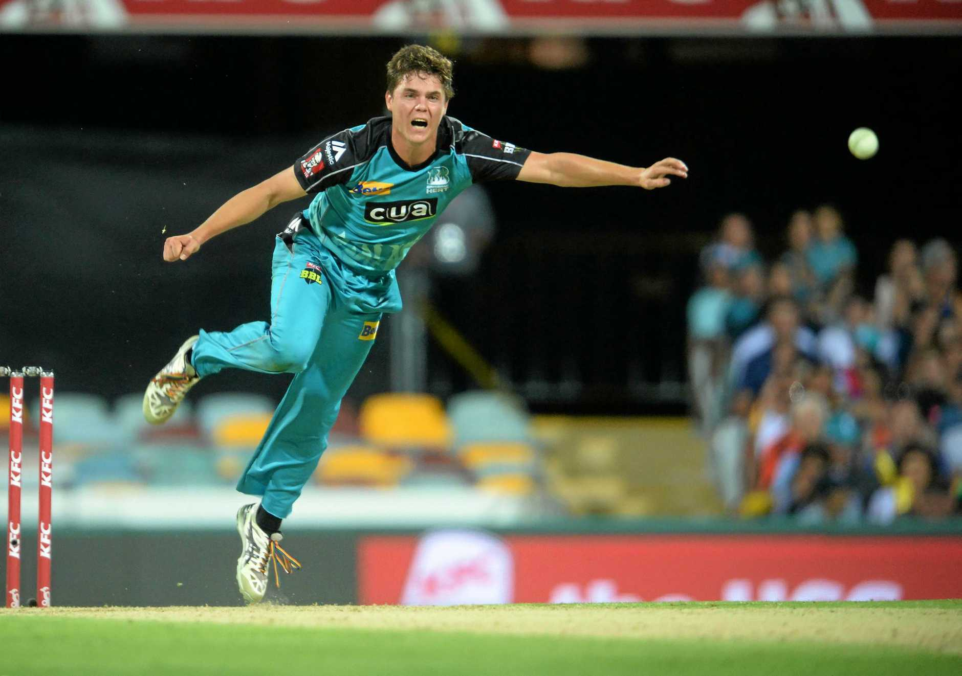 Mitchell Swepson bowls for the Brisbane Heat in the Big Bash League.
