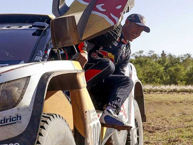 French driver Stephane Peterhansel of Peugeot celebrates his win in the car category.