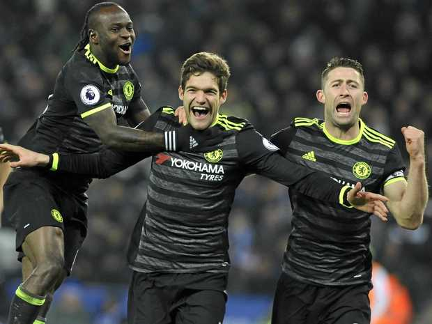 Chelsea's Marcos Alonso (centre) celebrates scoring his second goal during the English Premier League match against Leicester City at the King Power Stadium.