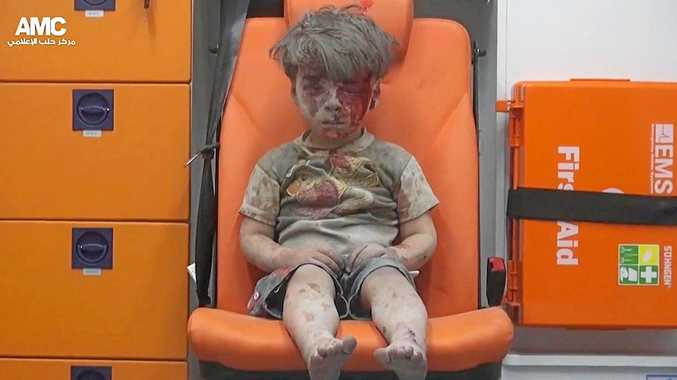 BOMBING VICTIM: Five-year-old Omran Daqneesh sits in an ambulance after being pulled out or a building hit by an airstrike, in Aleppo, in August.