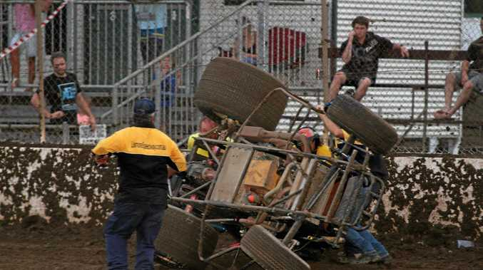 An official inspects the scene following one of several crashes during the 100-lap Wingless Sprintcars Australian Grand Prix at Lismore Speedway on Saturday night.