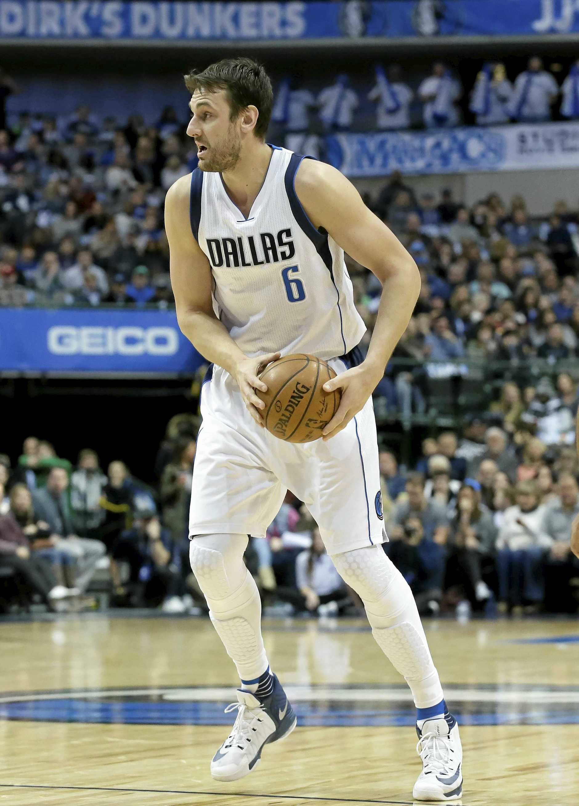 Dallas Mavericks centre Andrew Bogut looks to pass.