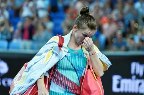 Simona Halep after losing her match to Shuai Zhang