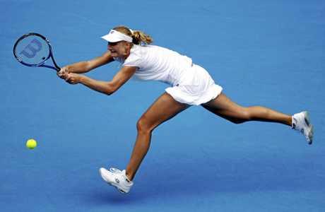 Ekaterina Makarova returns a ball to Ana Ivanovic