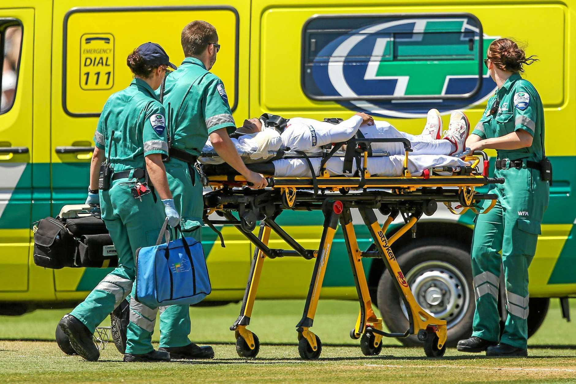 Mushfiqur Rahim of Bangladesh is stretchered into an ambulance.