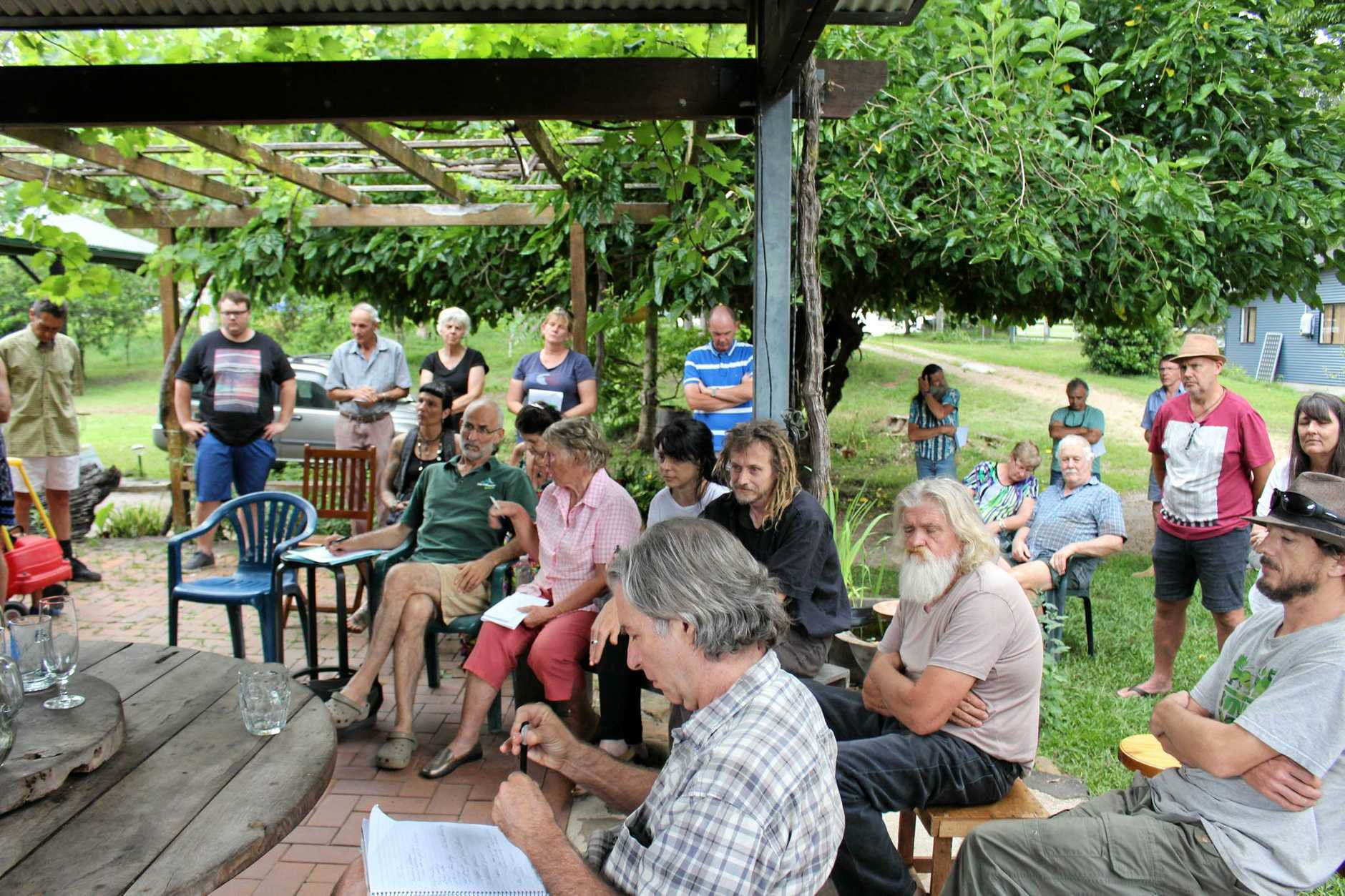 Rowlands Creek Rd residents are concerned about a development application to extract 24-megalitres of water per year from their community. Pictured here at a public meeting on the issue in late 2016.