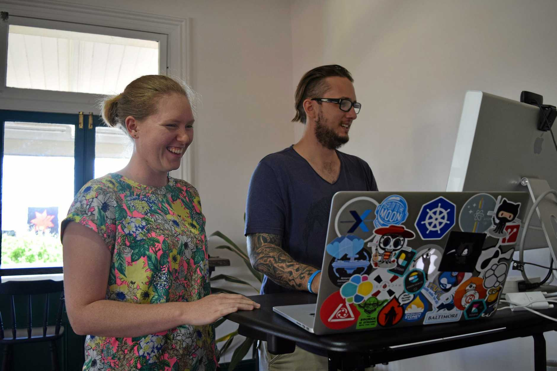 GETTING IT DONE: Eleanor Carey with web developer Nick Schuch, who uses the space every day.