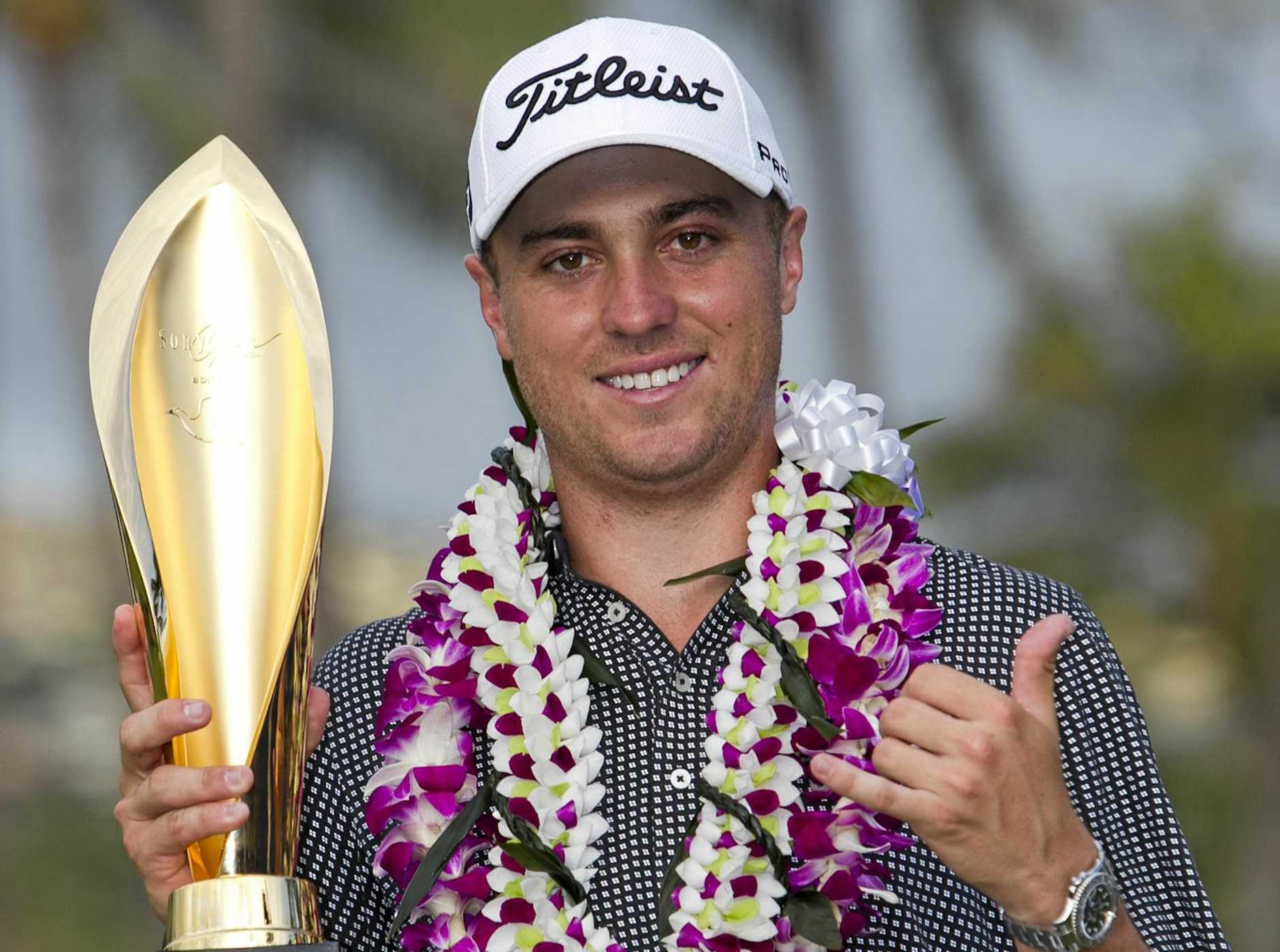 Justin Thomas holds the trophy after winning the Sony Open golf tournament.