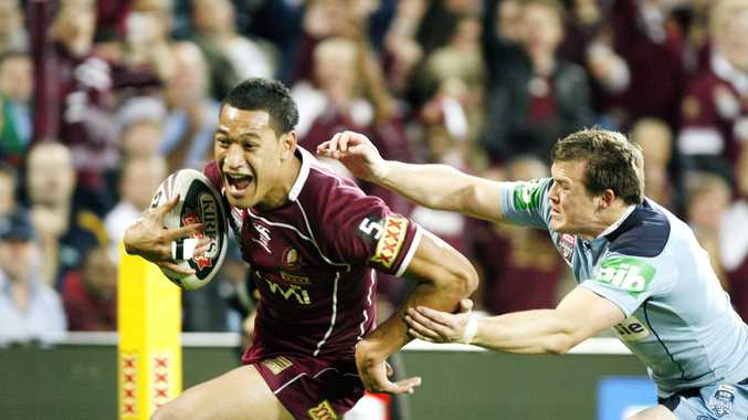origin1. Israel Folau escapes Brett Morris' clutches as he scores his first try of game two of the 2010 State of Origin. Photo: Claudia Baxter JN1810BC