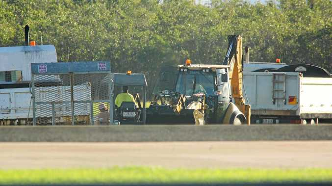 Work crews undertake repairs to the tarmac at the Whitsunday Coast Airport on Monday.
