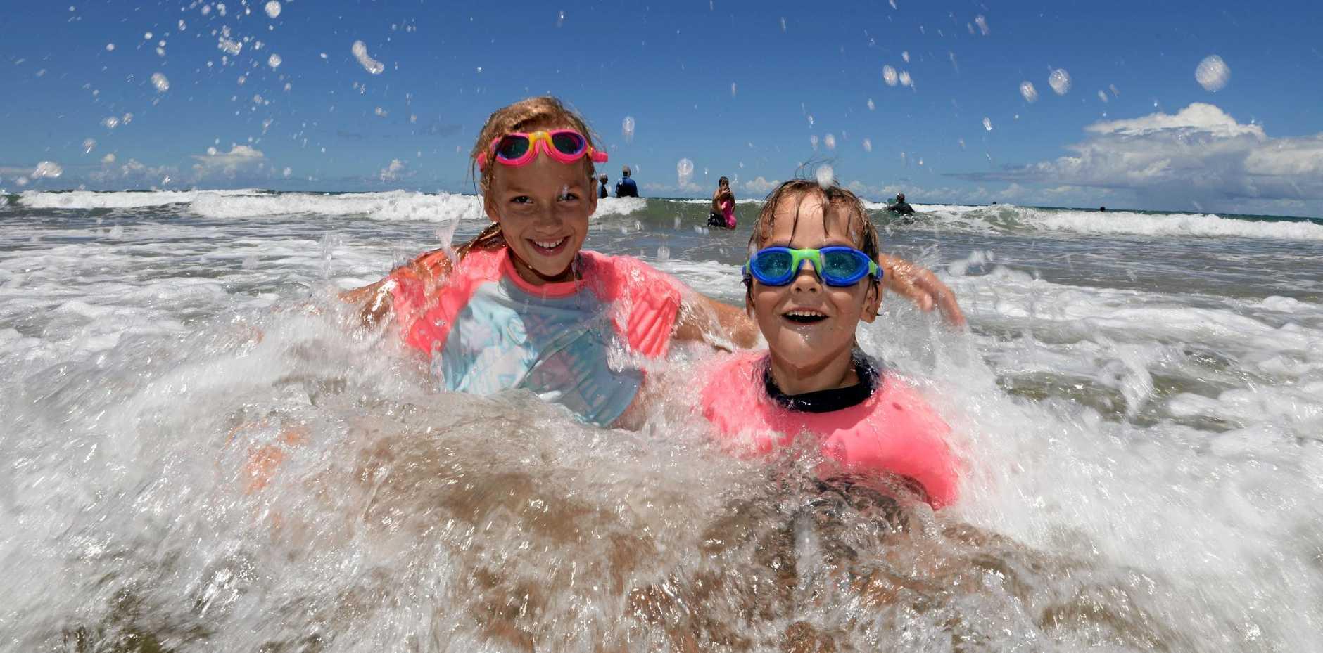 SUMMER WEATHER: Brisbane visitors Juliet and Harvey Taylor enjoying the surf on a hot day at Bargara.