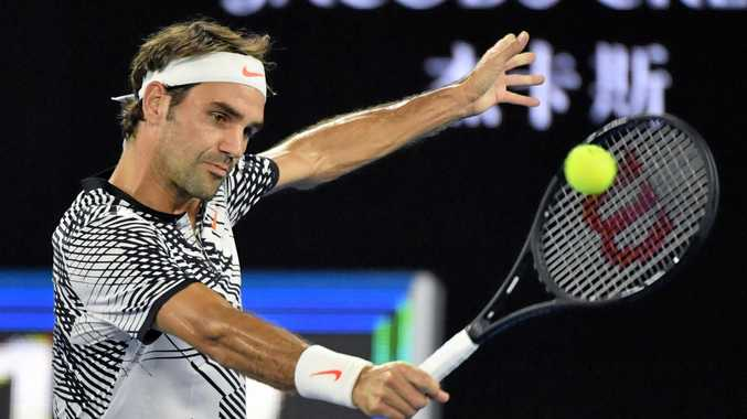 Roger Federer returns a shot against Austria's Jurgen Melzer in the first round of the Australian Open in Melbourne.