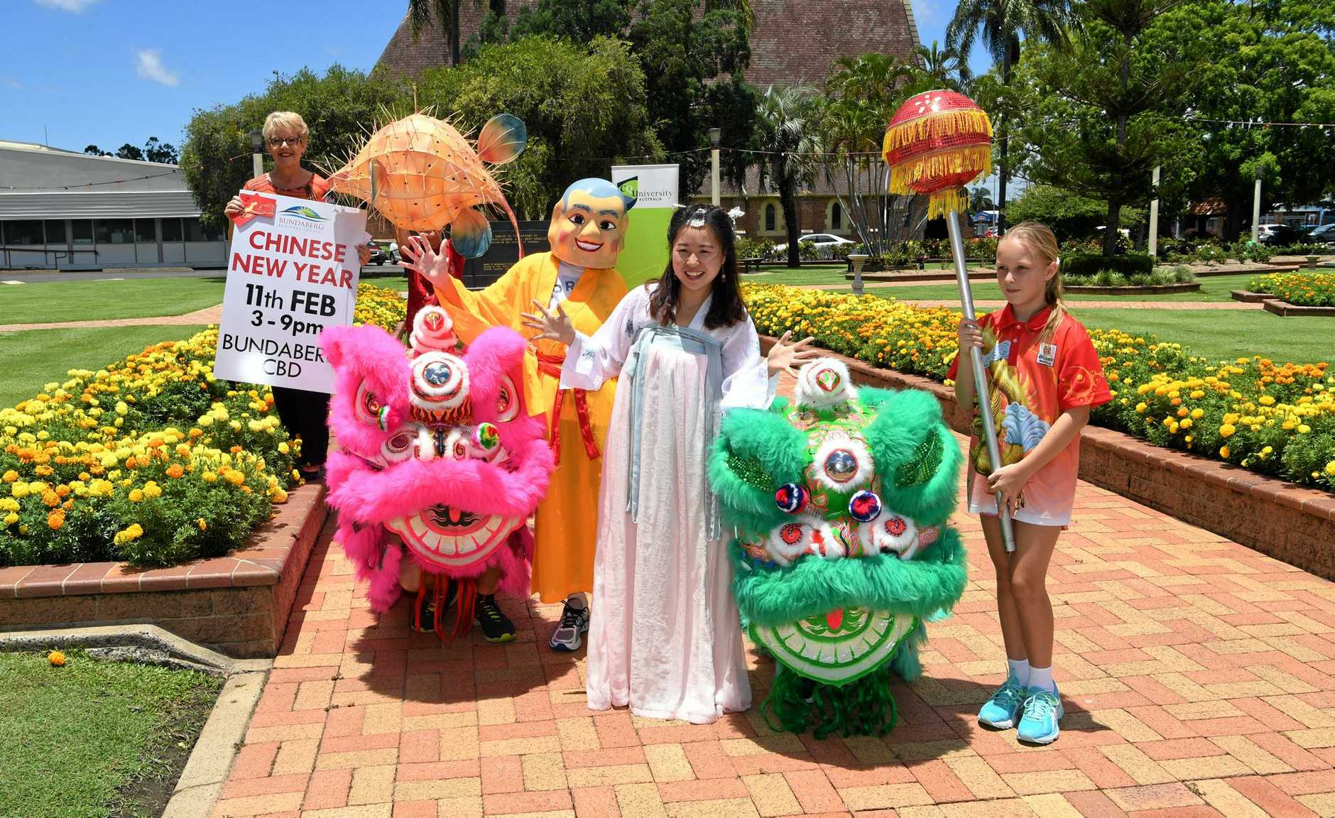 YEAR OF THE ROOSTER: Councillor Judy Peters, Dylan Carter as Buddha), Tina Yuanyuan, Lilly Matthews and the PCYC Blazers dragons are gearing up for Chinese New Year.