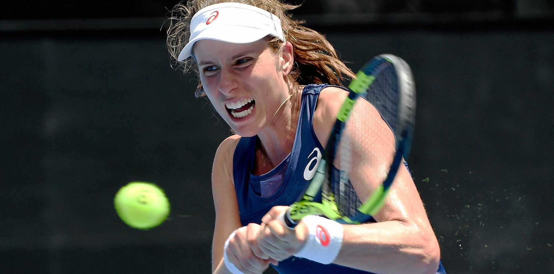 Johanna Konta of Great Britain in action against Kirsten Flipkens of Belgium.