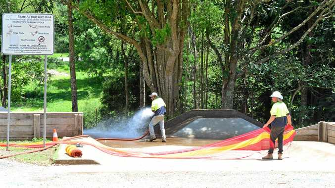CLEANUP: Workers hose off the Maleny skate park after fixing a sewage leak.