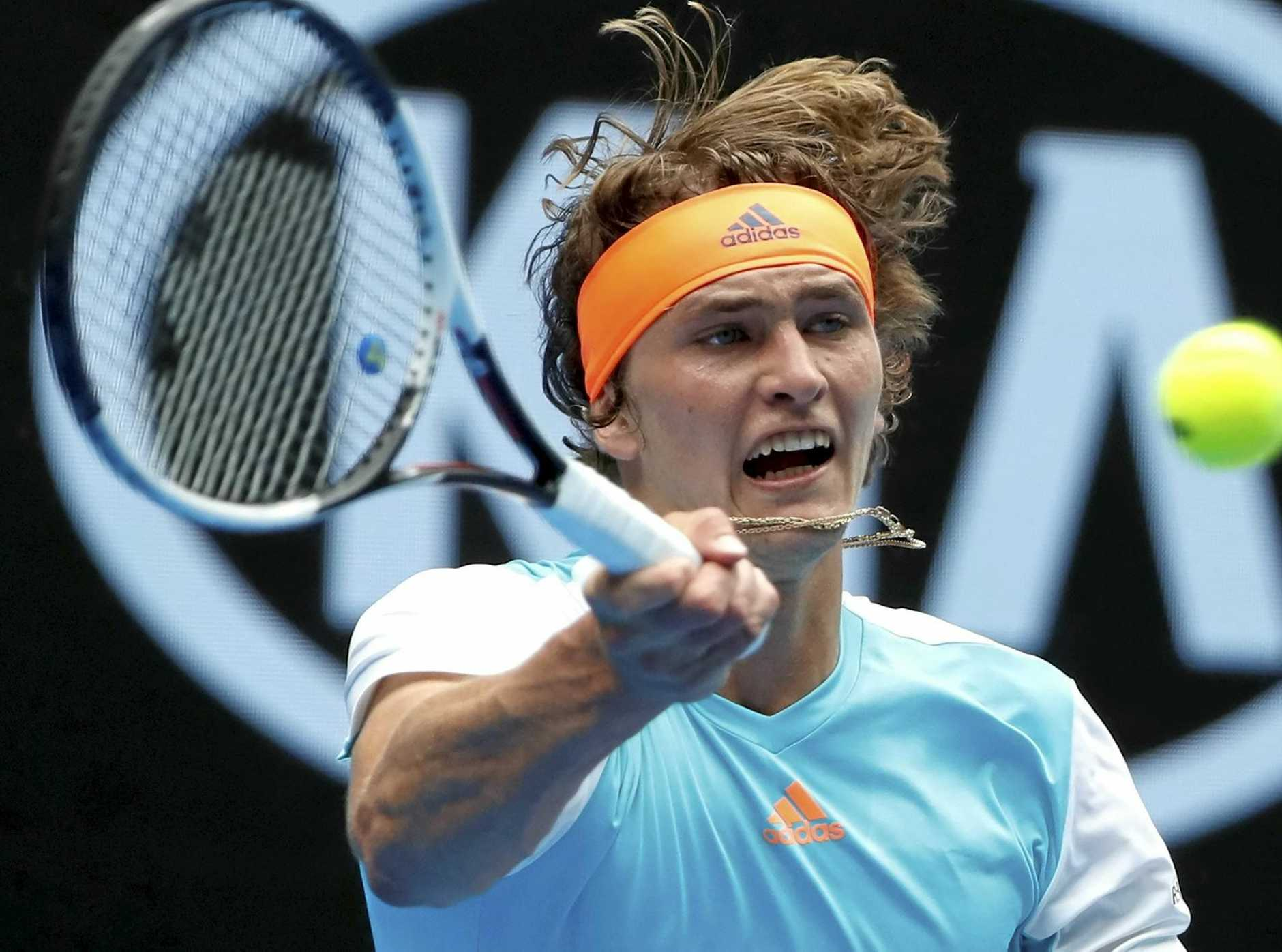 Germany's Alexander Zverev makes a forehand return to Robin Haase of the Netherlands.