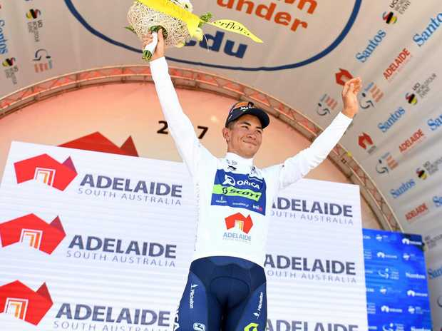 Australian rider Caleb Ewan of team Orica-Scott waves to the crowd after winning stage one of the Tour Down Under.