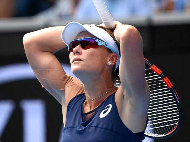 Australian Samantha Stosur shows her emotions during her loss to Heather Watson of Great Britain in round one of the Australian Open.