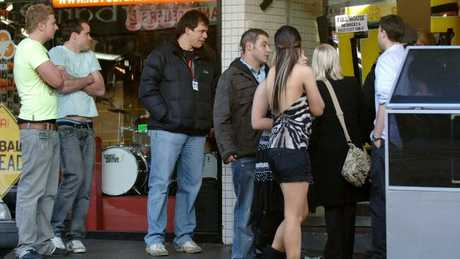 Patrons outside a nightclub early on a Sunday morning.Source:News Corp Australia