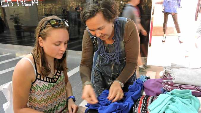 GETTING CRAFTY: Jane Milburn (right) teaching Mikaela Moroney (left) to upcycle a t-shirt.  Photo Lucy Smith / Daily Mercury