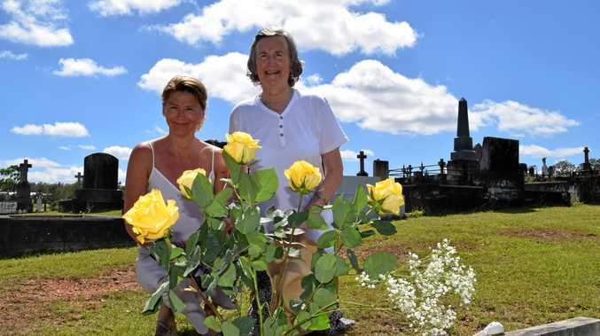 TIME TRAVEL: Anne and Bridget Scanlon at the grave of Maryann McSweeney, which Bridget travelled halfway across the world to visit.