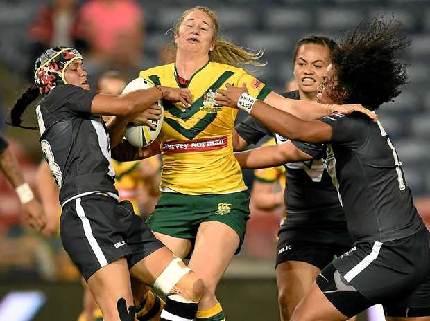 Kezie Apps of the Jillaroos is tackled by Nora Maaka (left) and Teuila Fotu-Moala of the Kiwi Ferns last year's trans-Tasman Test in Newcastle.