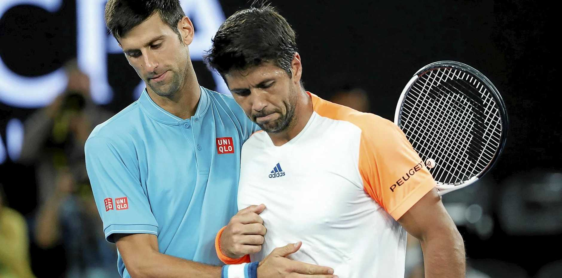 Novak Djokovic (left) of Serbia thanks Fernando Verdasco of Spain after their first-round match at the Australian Open.