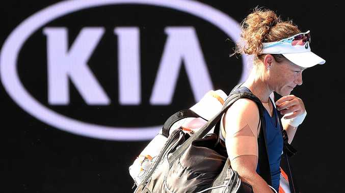 Samantha Stosur leaves Margaret Court Arena after being defeated by Heather Watson on day two of the Australian Open