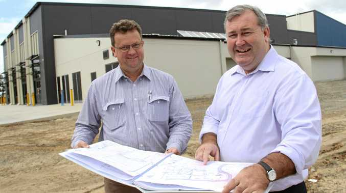 ECONOMIC BOOM: Andrew Murchie of Murchie Constructions, the successful contractor appointed for the construction of stage 2 of the Multi Use facility, with Bundaberg Mayor Jack Dempsey..