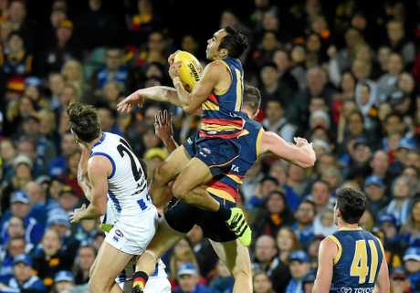 Eddie Betts soars above a pack to take this spectacular mark.