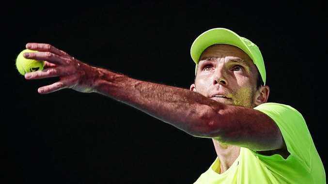 Ivo Karlovic of Croatia serves the ball to Horacio Zeballos of Argentina during their  first-round match at the Australian Open