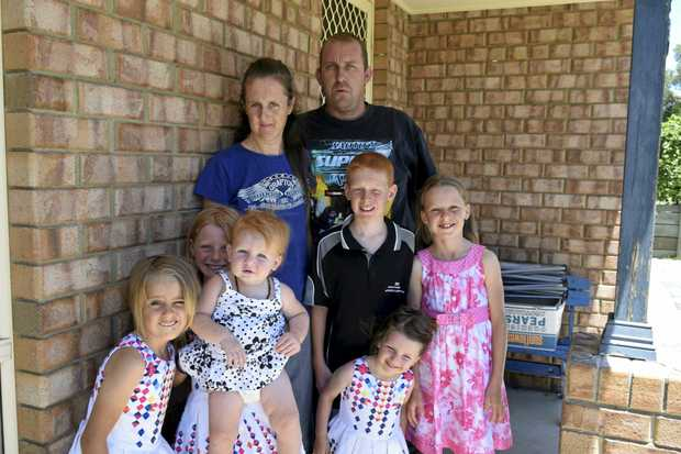DESPERATE: Melissa and Rob Rhodes and their six children have applied for more than 100 rental properties in the past three months.