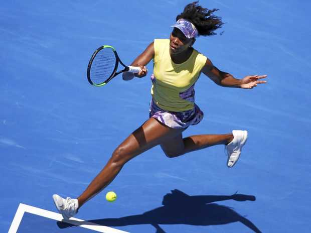 Venus Williams of the USA in action against Stefanie Voegele of Switzerland during round two of the Australian Open.