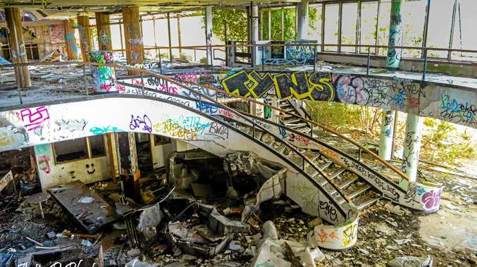 STAIRWAY TO RUIN: The Terranora Lakes Country Club lies in ruins, its once-opulent interior targeted by vandals.