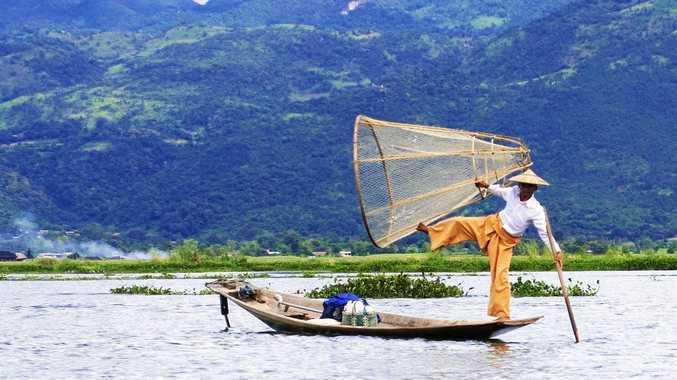 BALANCING ACT: A fisherman at work on Lake Inle in Myanmar.